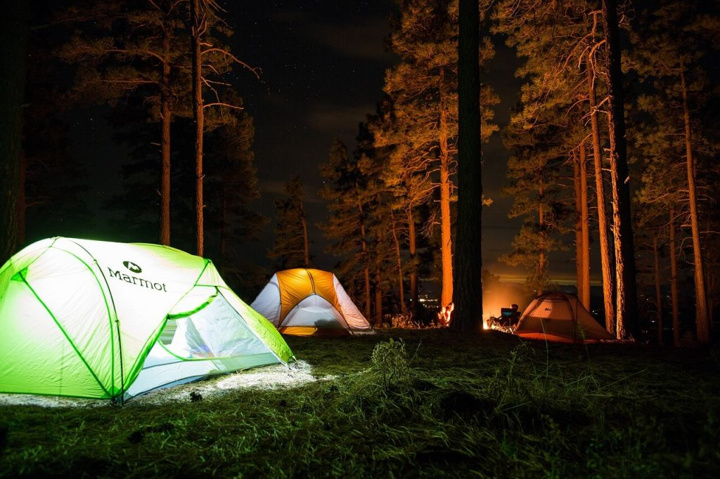 Camping at night with the best camping accessories