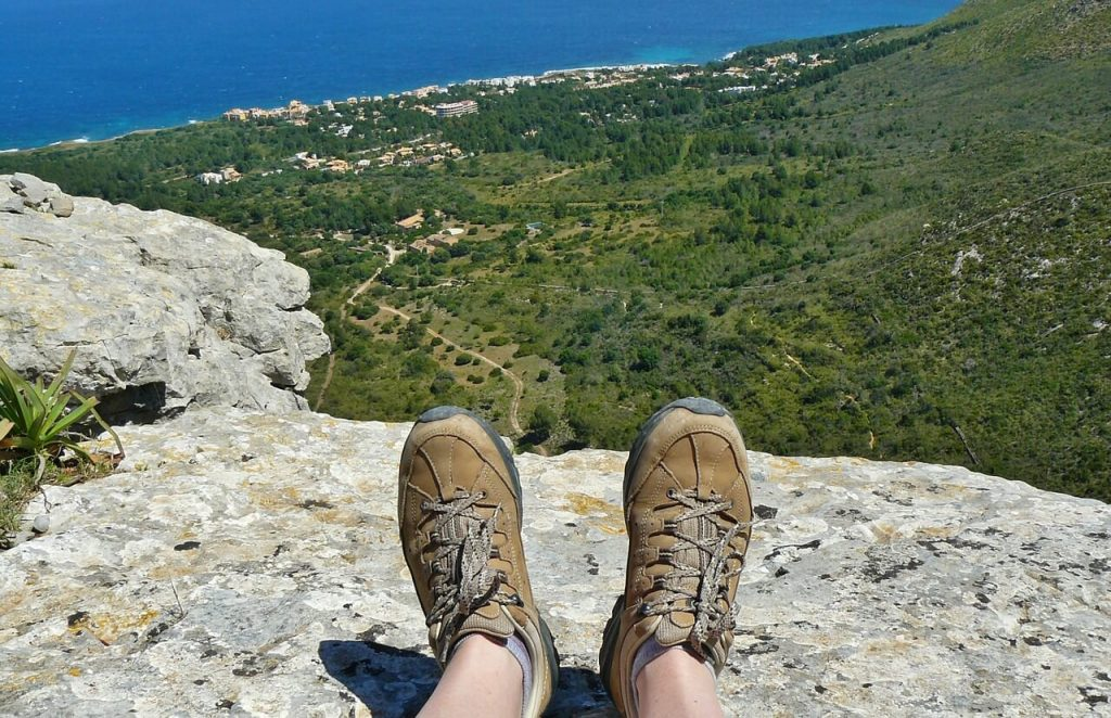 Hiker wearing hiking shoes looking at a view