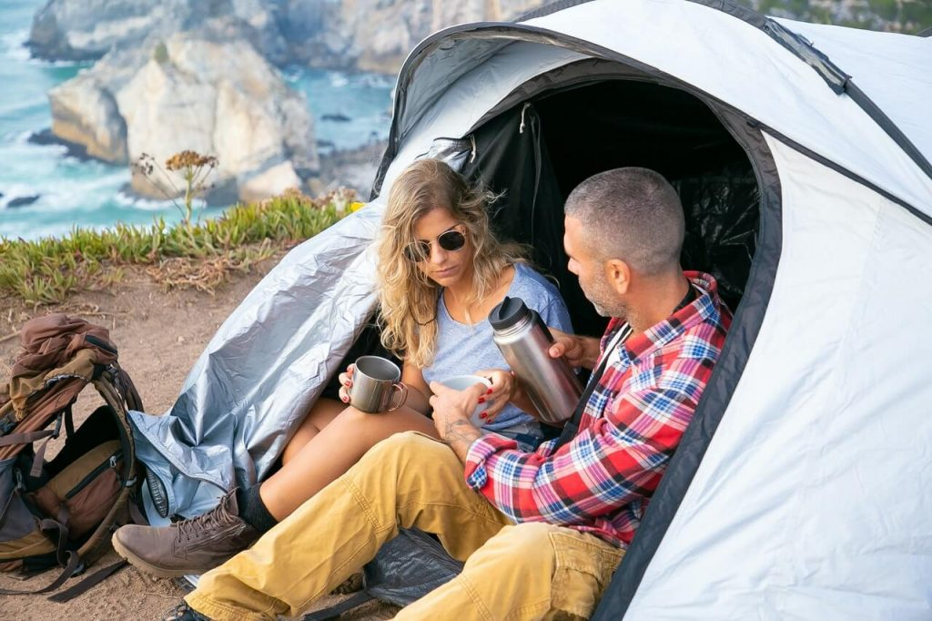 Two people in tent while camping