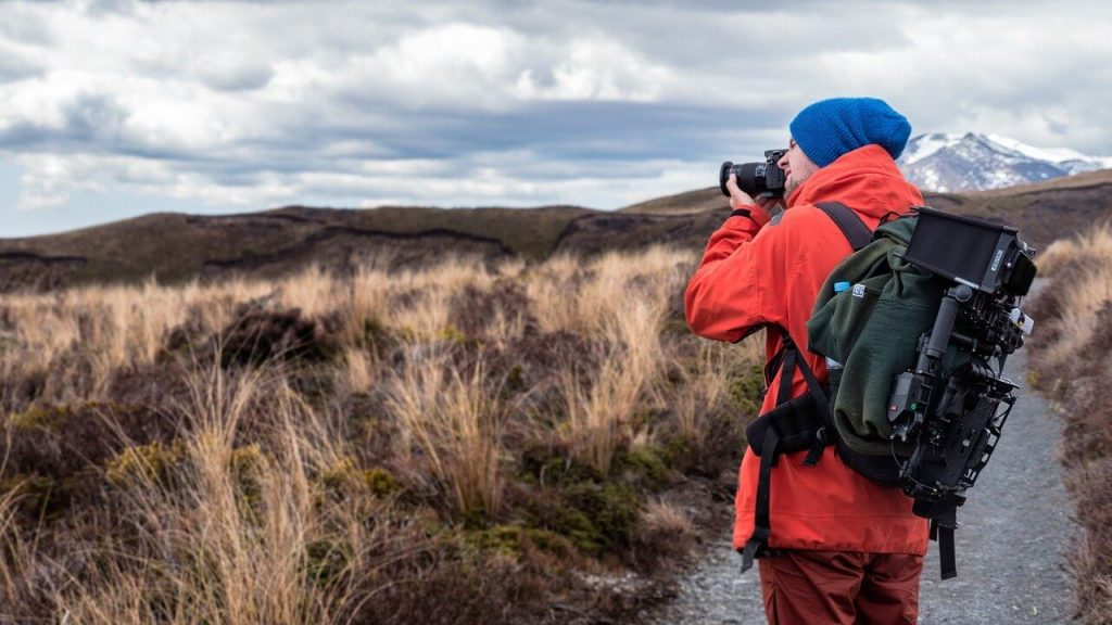 Photographer with hiking backpack