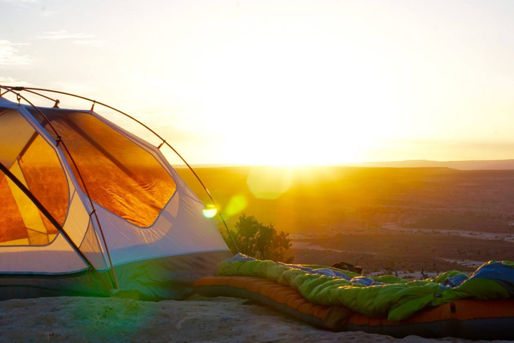 Camping scenery with sunshine and sleeping bags