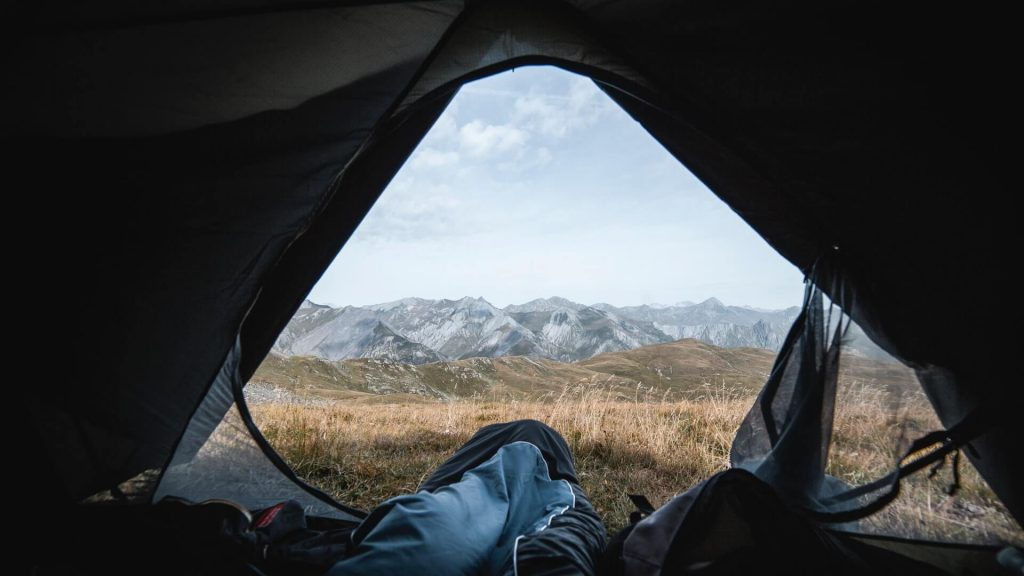 View outside camping tent with sleeping bag